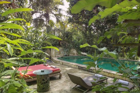 This famous property is set on 6700 sq. meters of tropical gardens overlooking extensive rice fields