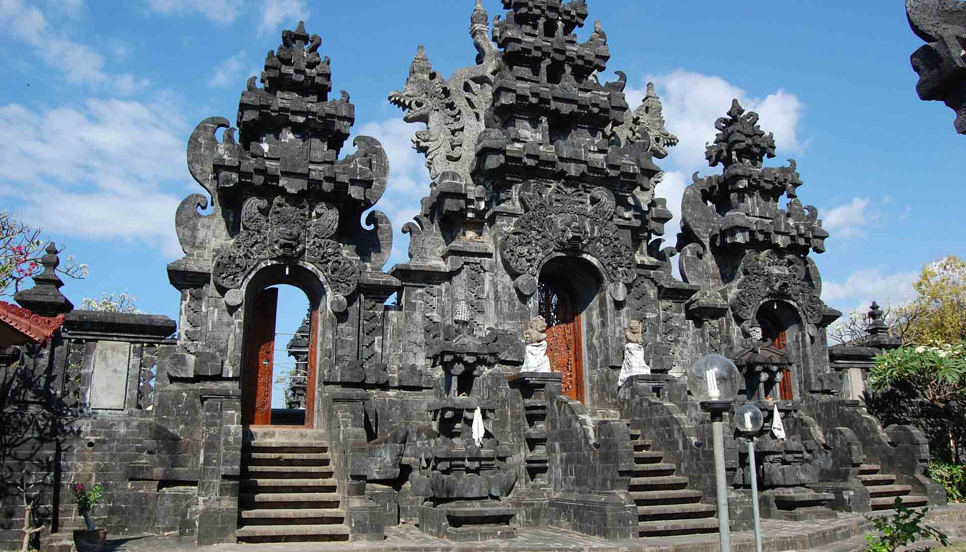 Constructed from black lava rock, Pura Ponjok Batu was built in the 15th century and overlooks a sma